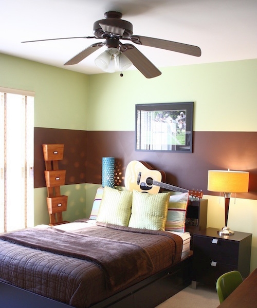 Teenager's bedroom painted green with a single wide horizontal brown stripe