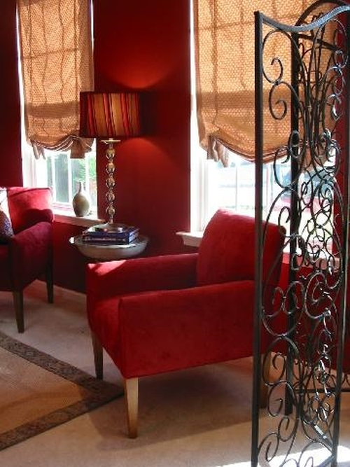 Rich, deep red wall color with black and golden accents