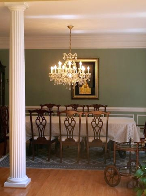 Formal dining room with the walls painted green