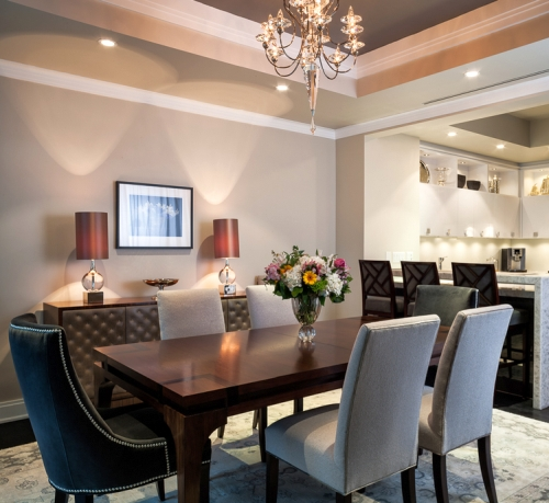 Contemporary dining room painted in different shades of taupe