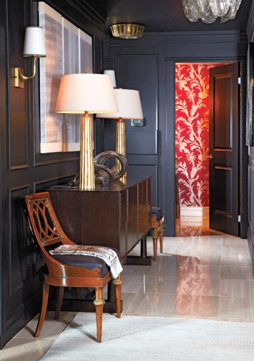 Navy blue wainscoted walls in a hallway