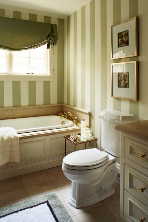 Cream and green vertical wall stripes in a bathroom