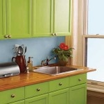 Idea for kitchen decorating: paint those cabinets!
