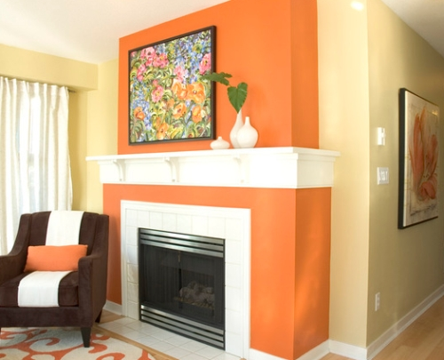 Pale yellow family room with an orange fireplace accent wall