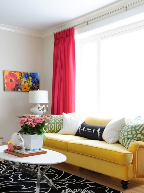 Greige painted room with red drapes and yellow couch