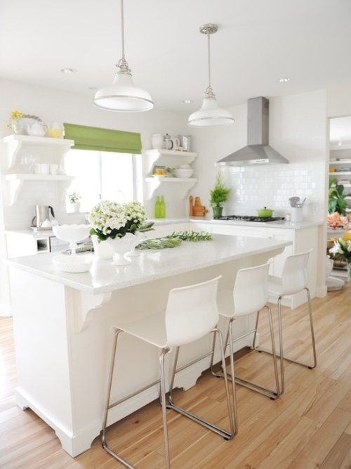 White kitchen decorated with green and yellow