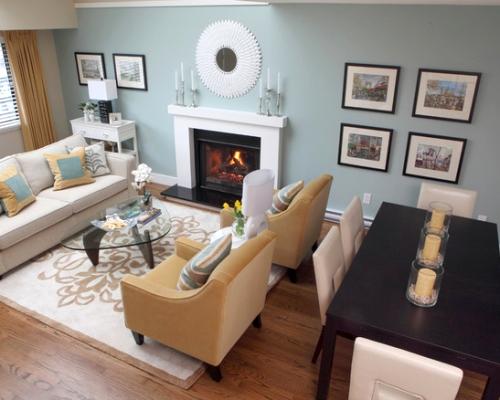 Living room with a french blue focal wall featuring a photo collection