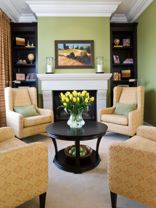 Green family room with bookcases painted black