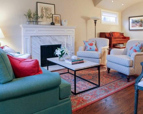 Beige living room with blue, green and red furniture and accents