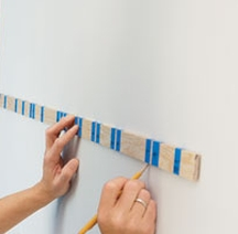 Mark the walls using your striping template