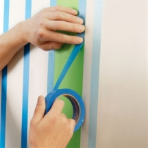 Tape the walls one stripe type at a time