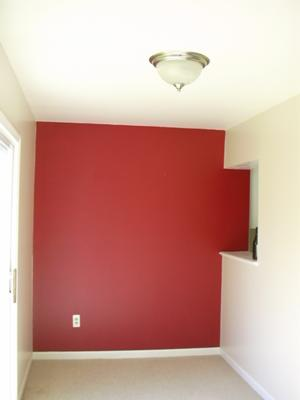 Vibrant red statement wall in my breakfast nook