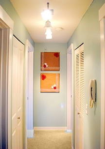 Draw attention to the end wall to make a long hallway seem shorter