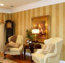 Faux painted wall stripes have depth and texture