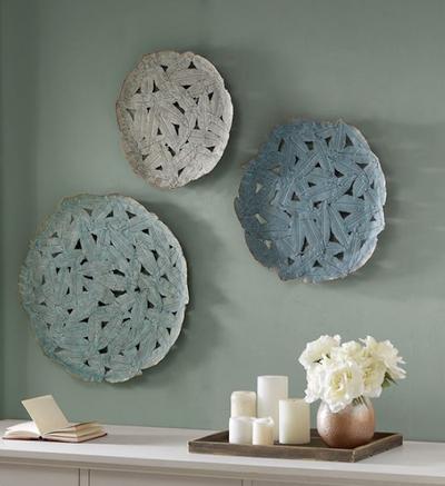 Asymmetrical wall plate decor