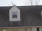 Cleaning roof shingles will brighten up a house