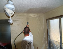 Spray painting popcorn ceiling texture