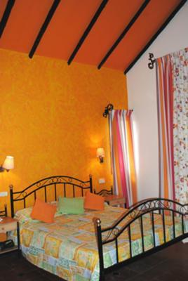 Added orange decorative pillows
