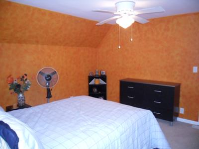 The 2 orange sponge painted walls