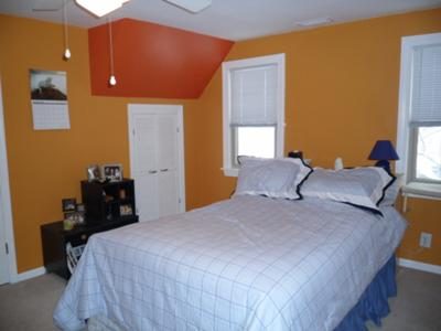 Pumpkin orange walls with a dark orange accent triangle