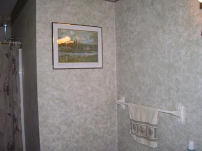 Master bathroom walls decorated with sponge painting