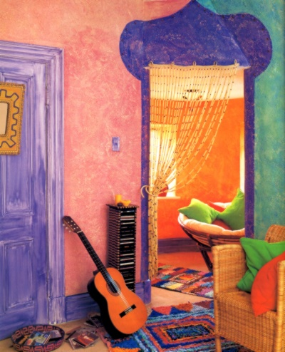 Flamboyant sponged off finish in a teen's bedroom, done in a Caribbean color scheme