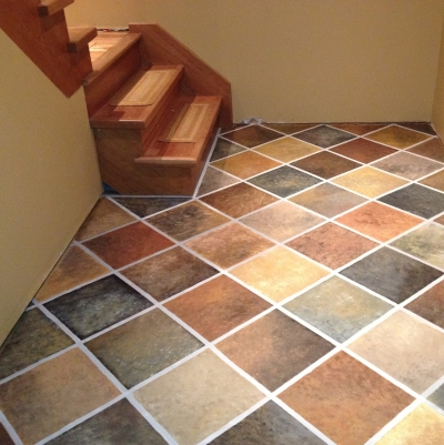 Sponge painting also lets you create the look of tile even on a linoleum floor