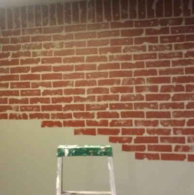 Faux painted brick created with a kitchen sponge