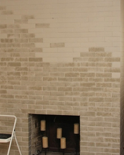 Fireplace brick wall enhanced with subtle paint sponging