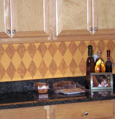 Kitchen backsplash decorated with a sponged on harlequin pattern
