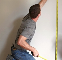 Measure the height of the walls to lay out horizontal wall stripes