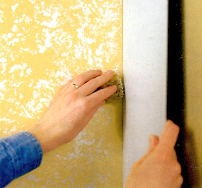 Use a cardboard as a shield for sponging in a corner