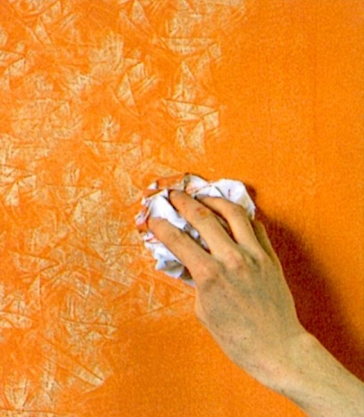 Rag all over the wet glaze to reveal the base coat