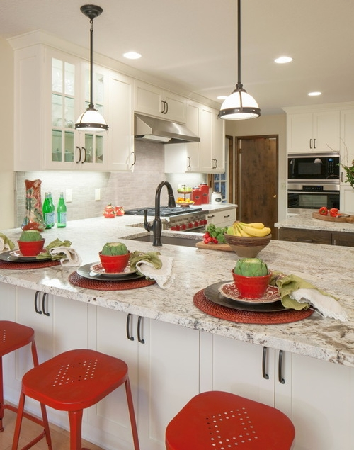 White kitchen with pops of red, green and yellow colors