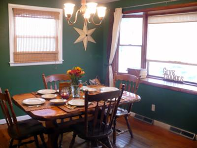 Country dining room painted a hunter green shade