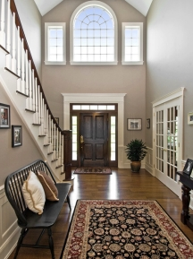 With decorative interior painting tricks, you can make a foyer look more inviting