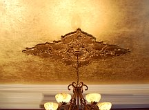 Gilded ceilings make a room look like a palace
