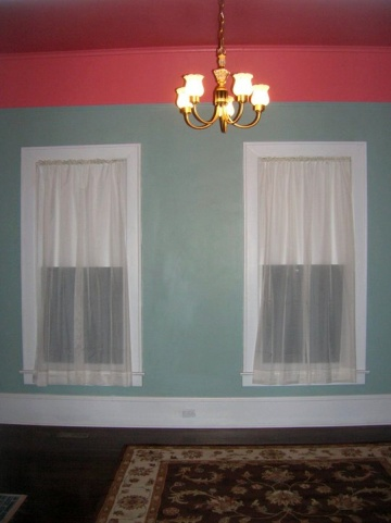 Room with sea green walls and a red ceiling