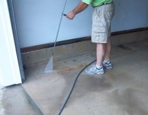 Power washing the floor before painting