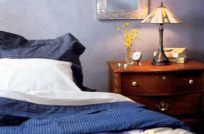 Similar shades of blue paint applied with a rag make the walls look like suede