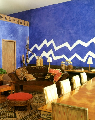 Royal blue ragged paint finish decorated with a zigzag border on one accent wall