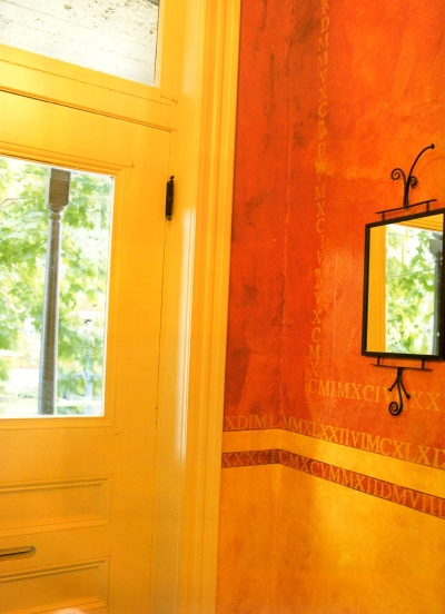 Rag painted and stenciled decorative wall finish in yellow and orange