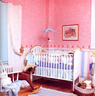 Pink baby room with a delicate white rag painted finish