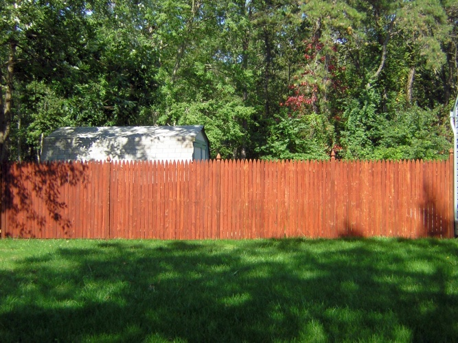 After: brightly stained fence