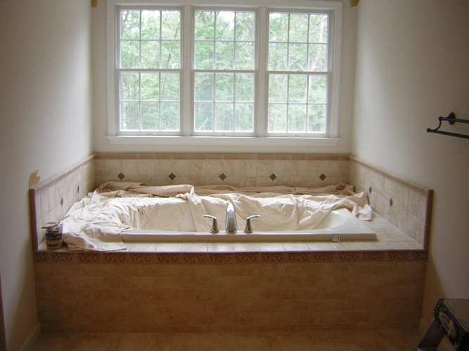 Before: unpainted bathroom