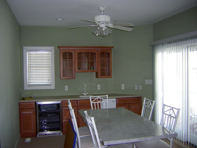 After: green paint color makes cabinetry stand out