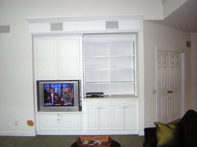 Before: unpainted built-in shelves