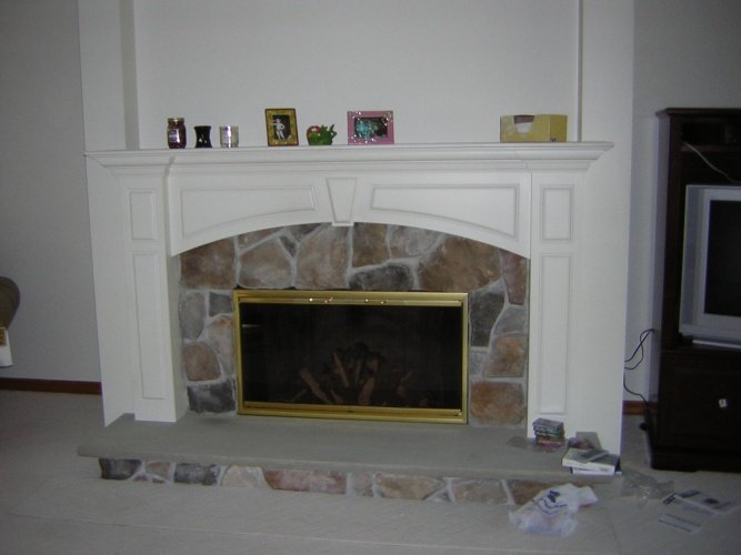 Before: white painted fireplace