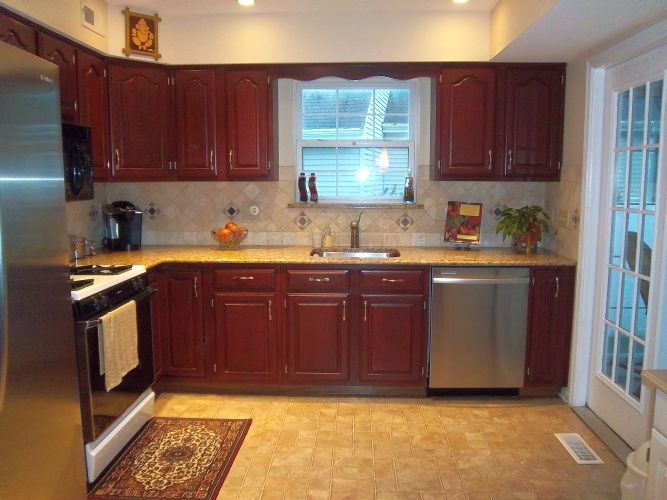 After: rich wine glaze on cabinets