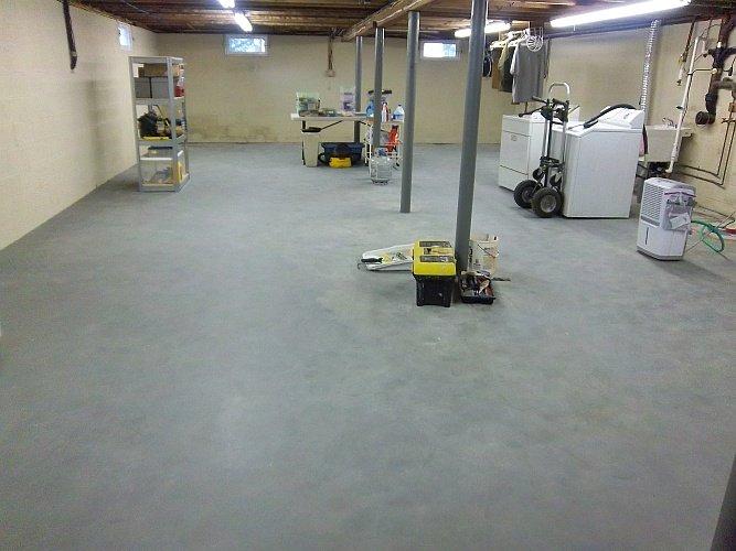 Before: blotchy basement floor